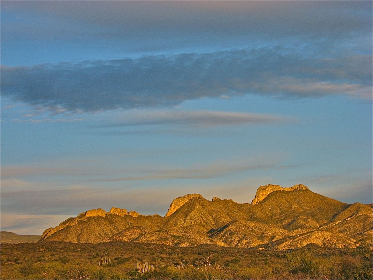 Sunset on the Devils's Spine, a rugged landmark in the Sonoran Sierras.